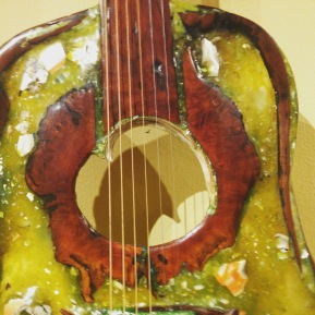 Close up of my Uncle's hand made art guitar.